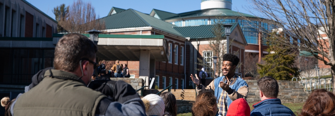 Campus scene man speaking to group