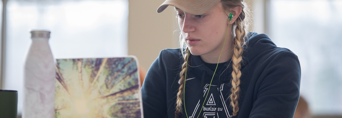 Student studying in atrium at Levine Hall