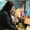 Communication Sciences and Disorders students wrapping presents