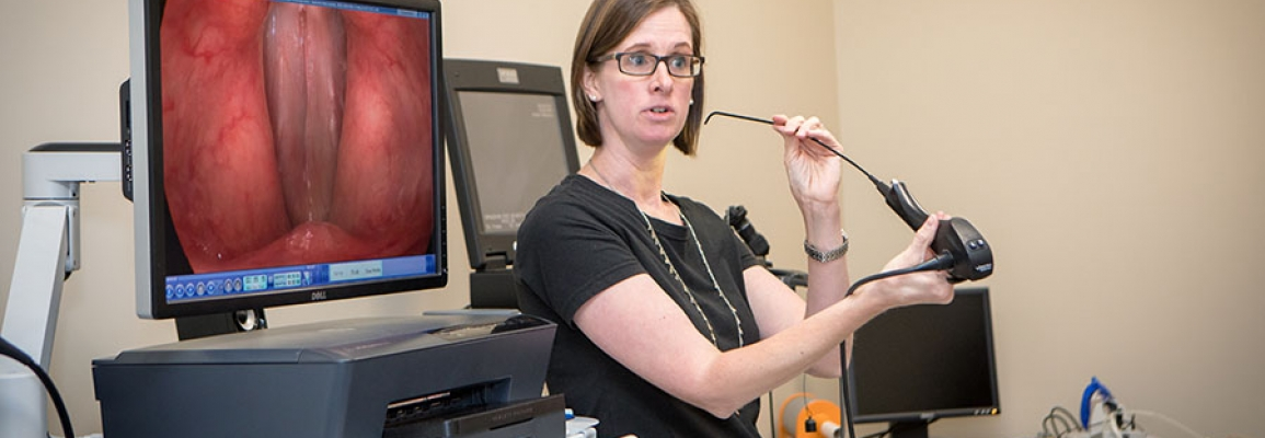 Dr. Jordan Hazelwood demonstrates specialized equipment used for visualization of the larynx.